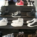 Top row, Kick It hightops; Middle row, Killers Zip Boots (left and right), Knight in black (center); Bottom row, Killers sneakers (left and right), Knight in white (center)